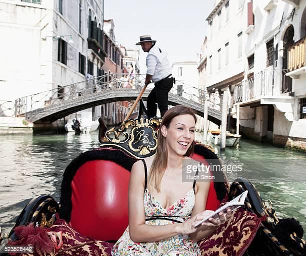 female tourist in gondola , venice, italy - hugh sitton fotografías e imágenes de stock