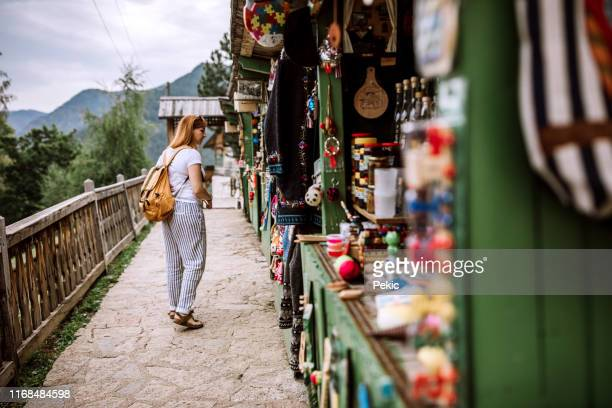 female tourist looking for souvenirs on street market - serbia stock pictures, royalty-free photos & images