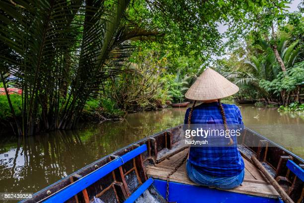 Female tourist on boat in Mekong River Delta, Vietnam