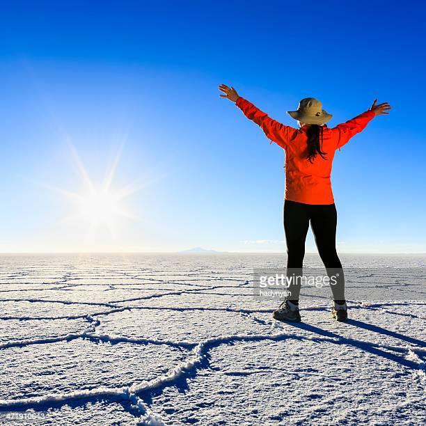 Female tourist on Salar de Uyuni, Altiplano, Bolivia