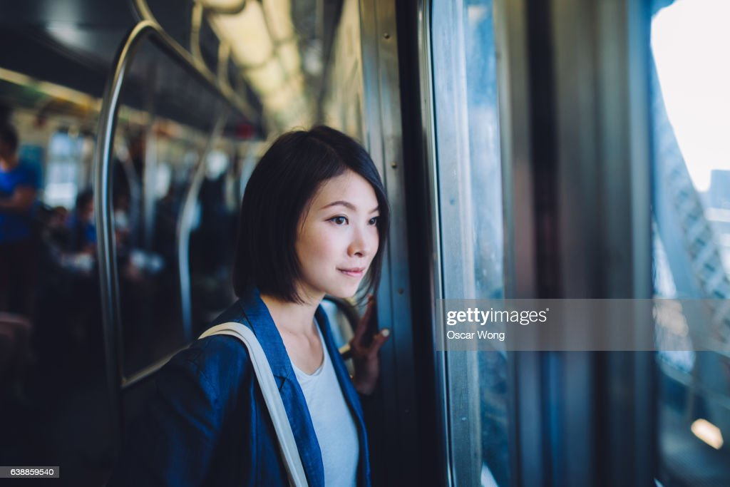Female tourist on subway : Stock Photo