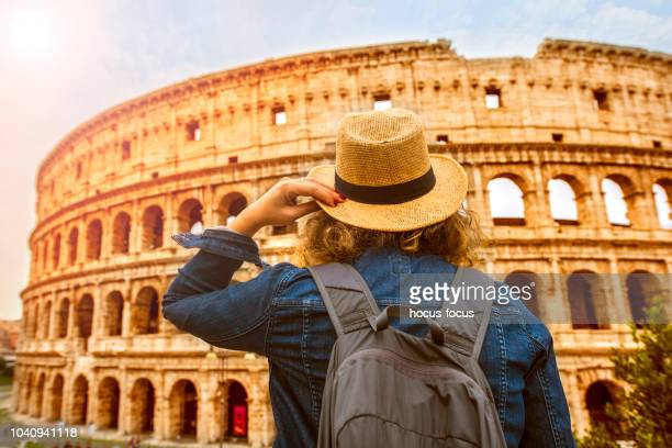 Female tourist on vacation in front of Colosseum Rome Italy