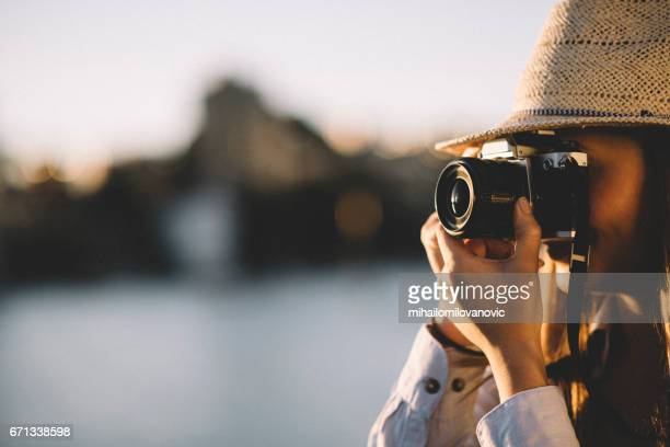 female tourist - photographer stock photos and pictures