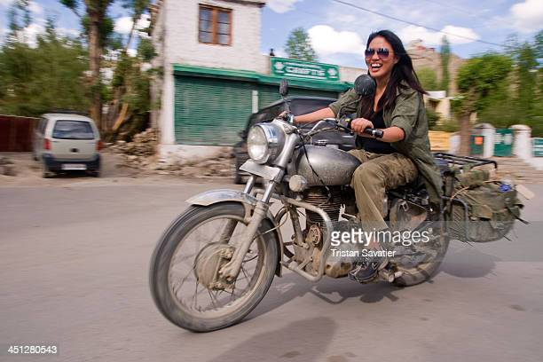 CONTENT] Female tourist riding a motorcycle in Leh Leh was the capital of the Himalayan kingdom of Ladakh now the Leh District in the Indian State of...