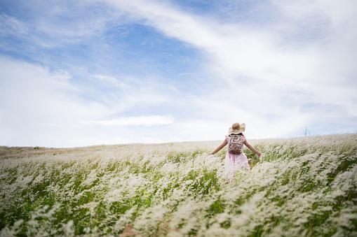 female tourist, she freely walks on the meadow. 1247827963