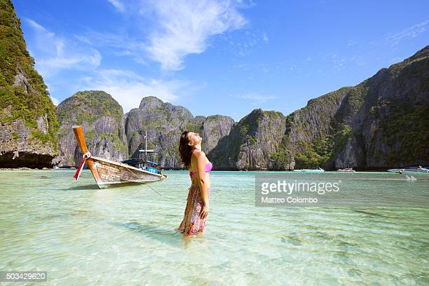 Female tourist standing in water on beautiful tropical beach, Thailand