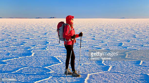 Female tourist standing on Salar de Uyuni, Altiplano Bolivia