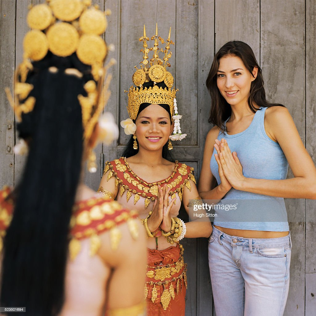 Female Tourist Standing with Traditional Dancers : Stock Photo