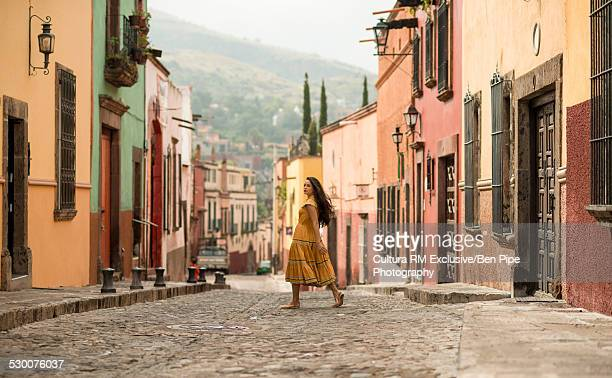 Female tourist strolling on street, San Miguel de Allende, Guanajuato, Mexico