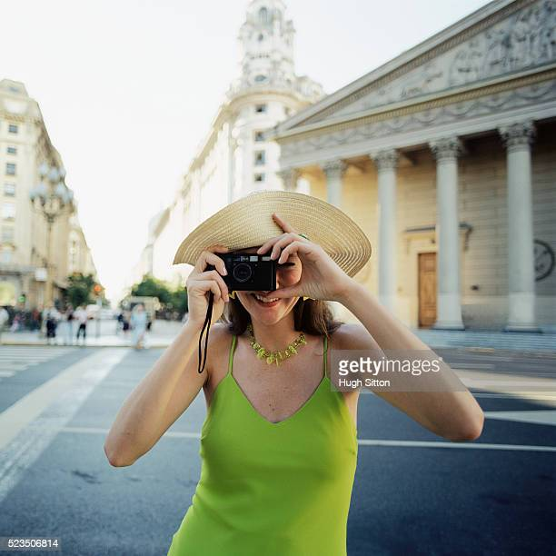 female tourist taking picture, plaza de mayo, buenos aires, argentina - hugh sitton stock pictures, royalty-free photos & images