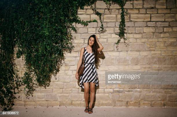 female tourist traveling in rovinj - striped dress stock photos and pictures