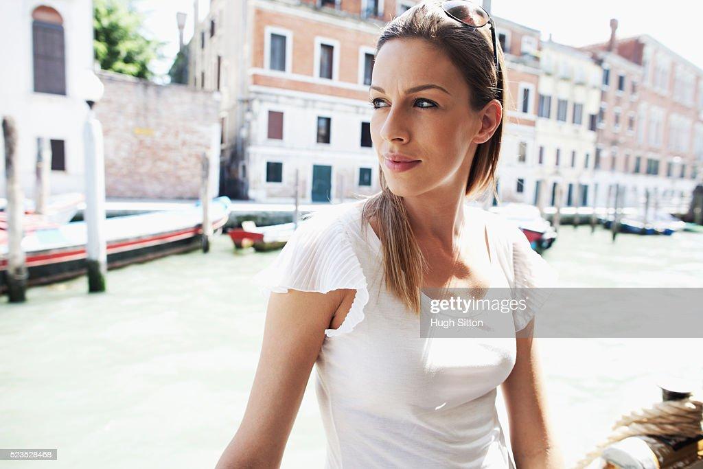 Female tourist traveling on public ferry, Venice, Italy : Stock Photo