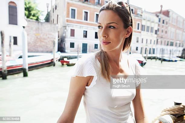 female tourist traveling on public ferry, venice, italy - hugh sitton photos et images de collection