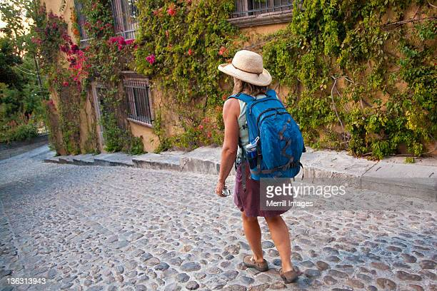 Female tourist walking on Mexican street