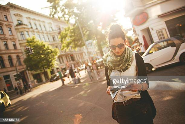 female tourist walking on the street in berlin - kreuzberg stock photos and pictures