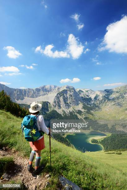 female tourist watching trnovacko lake in maglic mountain - montenegro photos et images de collection