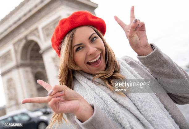 female tourist with a map in paris - national holiday stock pictures, royalty-free photos & images