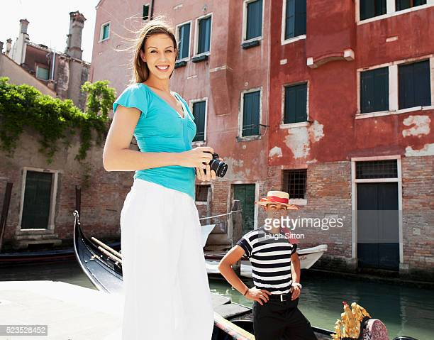 female tourist with gondola driver, venice, italy - hugh sitton stock pictures, royalty-free photos & images