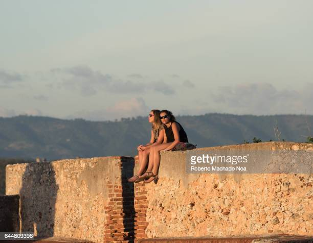 Female tourists enjoying the Sunset at Saint Peter of the Rock fortress The Spanish military construction is a Unesco World Heritage Site