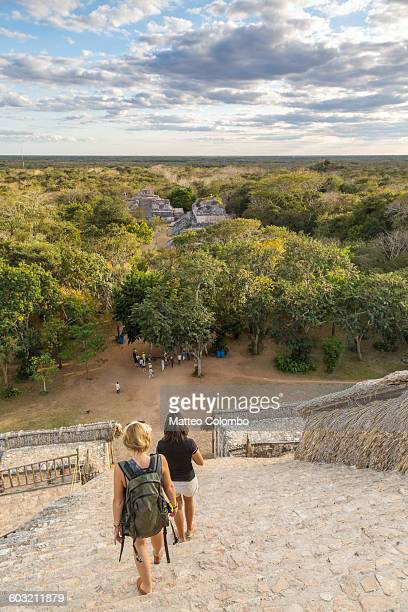 female tourists walking down old ruins, mexico - mayan people stock photos and pictures