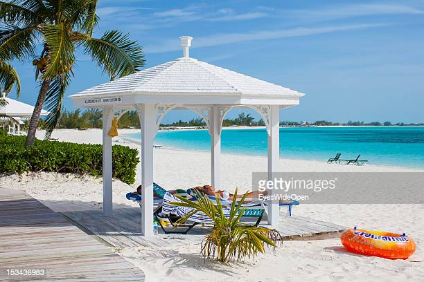 Female tourists women in a bikini are relaxing in the sun at luxury Resort and Hotel Cape Santa Maria which is having one of the Bahamas´ best...