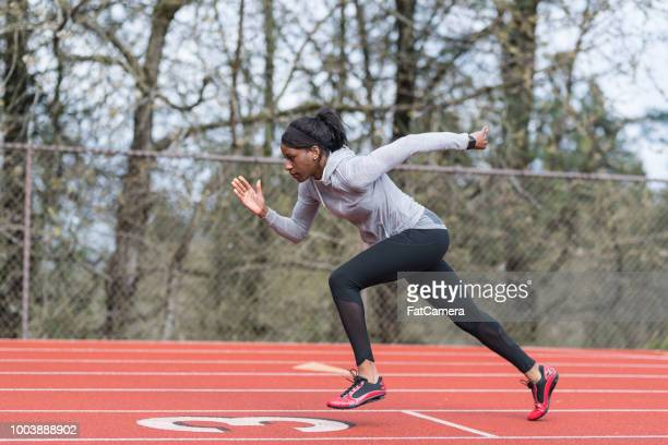 female track athlete training at stadium - sprint stock pictures, royalty-free photos & images