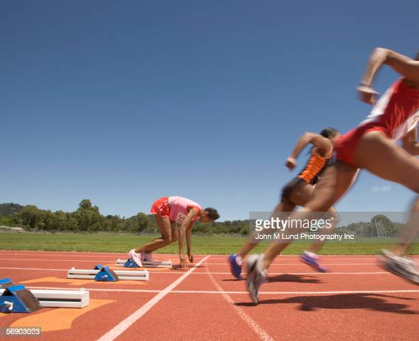 Female track runner lagging behind