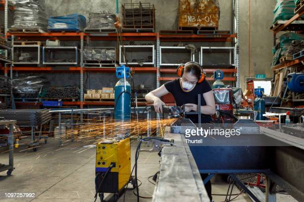 female tradesperson in workshop - trade union stock pictures, royalty-free photos & images