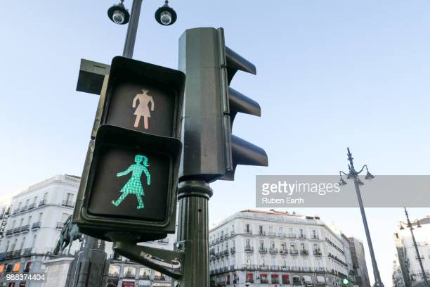 female traffic pedestrian green light in madrid city - igualdad de genero fotografías e imágenes de stock