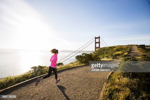A female trail running near the Golden Gate