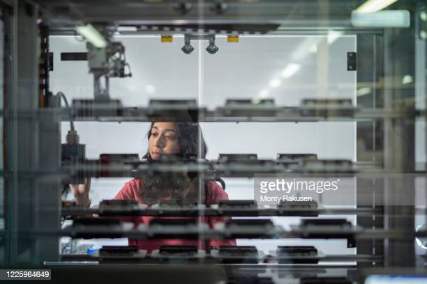 female trainee engineer inspecting robotic assembly line in unspecified. - females stock pictures, royalty-free photos & images