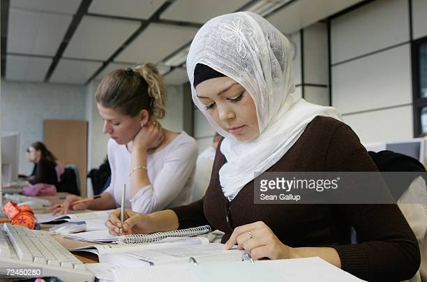 Female trainees including a young Muslim woman wearing a headscarf attend a class in office management at the Siemens Professional Education facility...