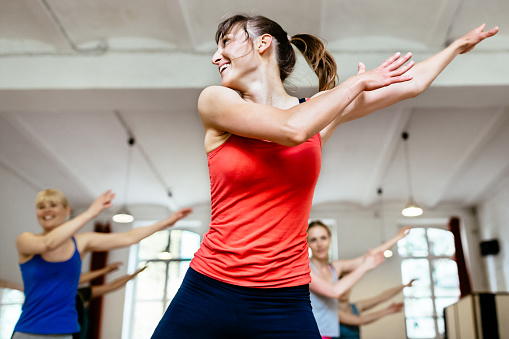 Female Trainer Infront Of Her Aerobics Class - gettyimageskorea