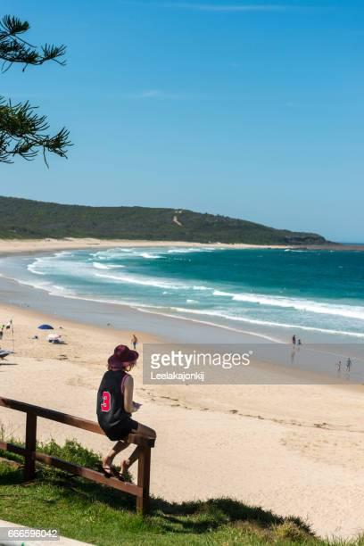 Female traveler in beach near Sydney Australia