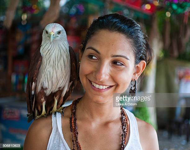 Female Traveler with Bald Eagle on Shoulder