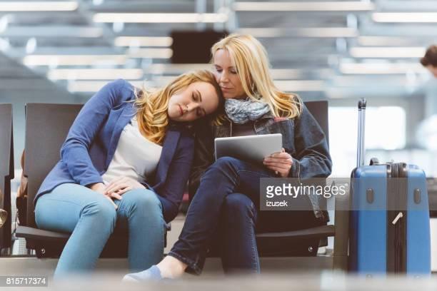 Female travelers at airport waiting room