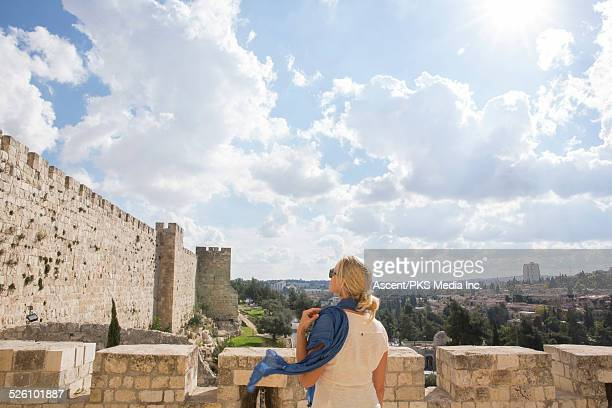 female traveller looks at city wall, jaffa gate - israeli woman stock pictures, royalty-free photos & images