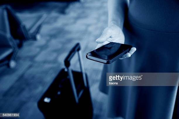 Female traveller using smartphone