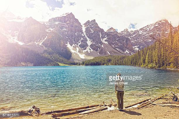 female traveller viewing alpine lake and mountains