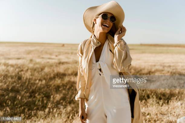 female traveller with straw hat and sunglasses - beige stock pictures, royalty-free photos & images