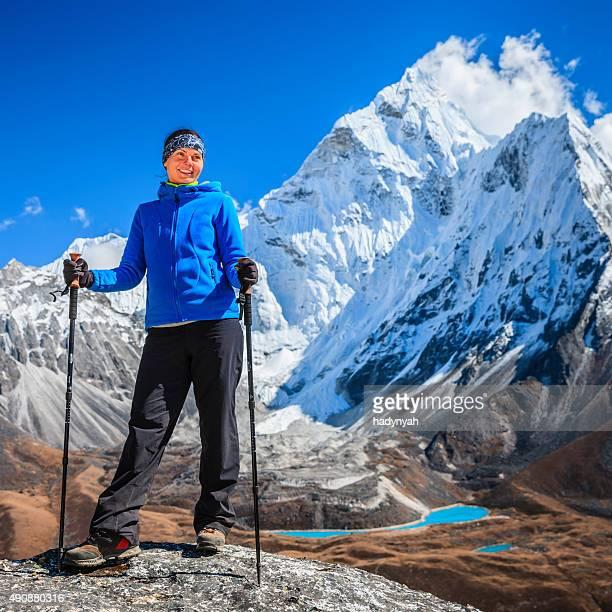 Female trekker looking over Himalayas, Mount Everest National Park