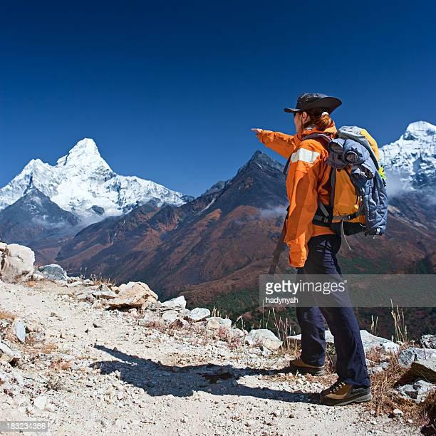 female trekker pointing at mount ama dablam - khumbu stock pictures, royalty-free photos & images