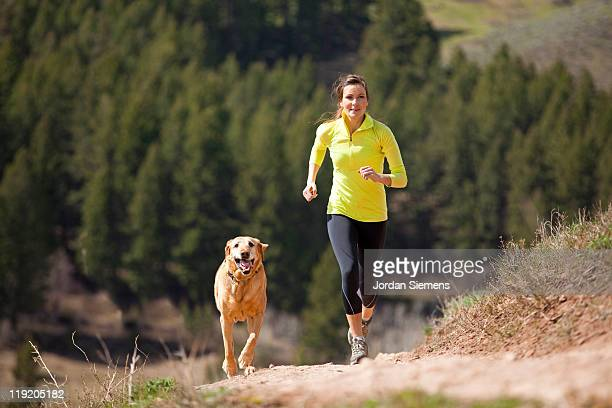 Female trial running with her dog.