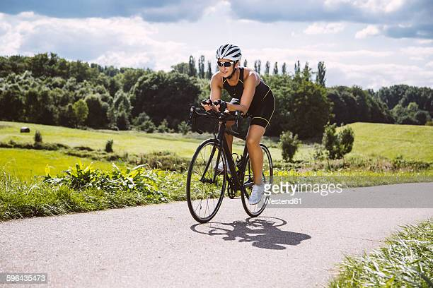 Female triathlete riding her racing bike