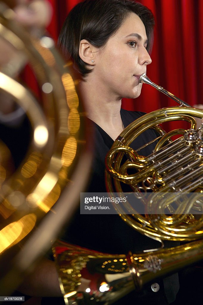 Female Trombonist Performing in an Orchestra : Stock Photo