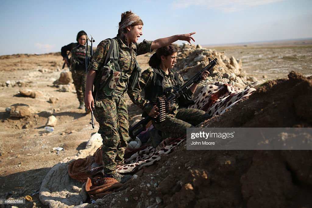 Female Troops from the Syrian Democratic Forces take up positions near the frontline on November 10, 2015 near the ISIL-held town of Hole in the autonomous region of Rojava, Syria. The forces, a coalition of Kurdish and Arab units, are attacking ISIL extremists in the area near the Iraqi border. The predominantly Kurdish region of Rojava in northern Syria has become a bulwark against the Islamic State. Their mostly Kurdish armed forces, with the aid of U.S. airstrikes and weapons, have been battling ISIL, who had earlier captured much of the region from the Syrian regime.