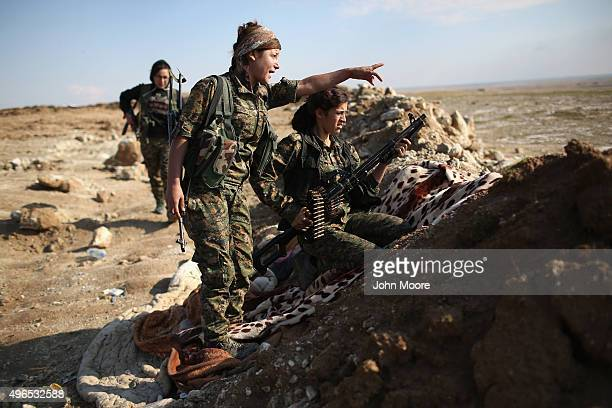 Female Troops from the Syrian Democratic Forces take up positions near the frontline on November 10 2015 near the ISILheld town of Hole in the...