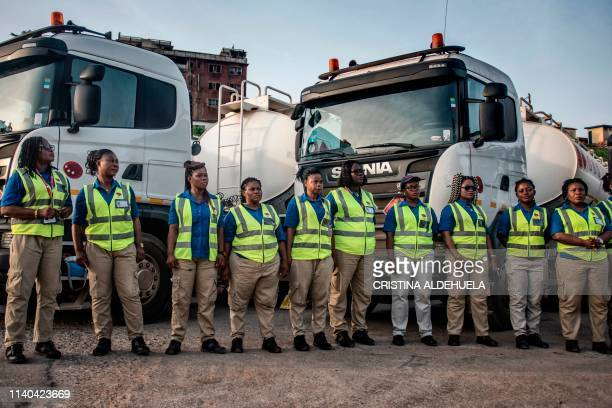 Female truck drivers stand at the Ladybird Logistics meeting point before the start of the workday in Takoradi, western Ghana, on April 3, 2019. -...