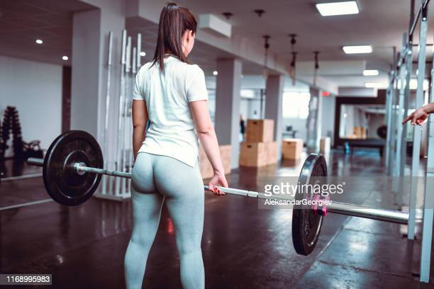 female trying to maintain balance during deadlift exercise - buttocks stock pictures, royalty-free photos & images