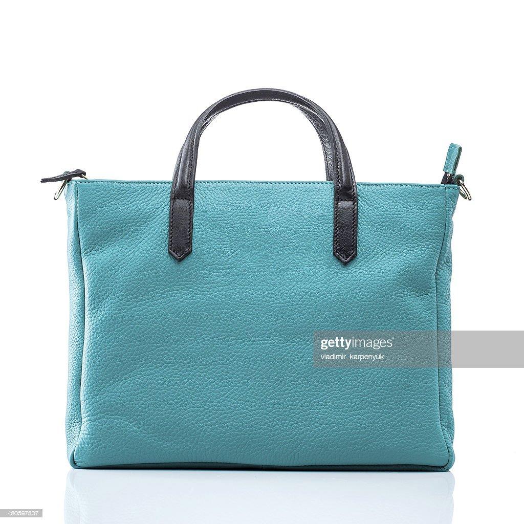 female turquoise leather handbag : Stock Photo